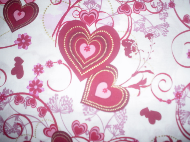 Valentines with Metallic Accents-Red Valentines on white with swirls and metallic accents. Manufactored for Hoffman Fabrics. 44 wide and 100% cotton.